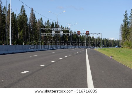 NOVOPRIOZERSK HIGHWAY, LENINGRAD OBLAST, RUSSIA - SEPTEMBER 11, 2015: Opening of new stretch of Novopriozersk highway. Construction began in 2013 - stock photo