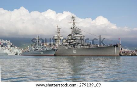 "NOVOROSSIYSK, RUSSIA, MAY 9, 2015. Artillery cruiser ""Mikhail Kutuzov"" in the port of Novorossiysk. Artillery cruiser ""Mikhail Kutuzov"" branch of the Museum of Black sea fleet in Novorossiysk - stock photo"