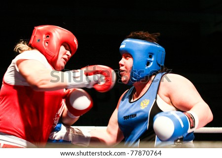 NOVOSIBIRSK - MAY 21: Russian Championship in women's boxing. The final battle between Mikhailova  Valentina(red) and Sinetskaya Irina(blue) on May 21, 2011, Novosibirsk Russia