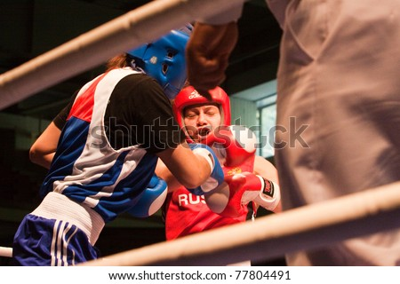 NOVOSIBIRSK - MAY 20: Russian Championship in women's boxing. The semi-final battle between  Ochigava Sofia(red) and Sablina Yuliya(blue) on May 20, 2011, Novosibirsk Russia