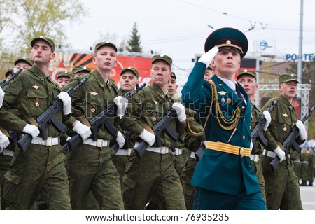 NOVOSIBIRSK - MAY 9: The on parade dedicated to Victory Day in Great Patriotic War, soldiers bearing arms demonstrate a willingness to protect on May 9, 2011 in Novosibirsk Russia