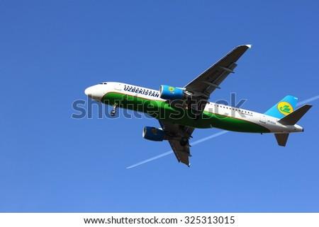 NOVOSIBIRSK - OCT. 08: Airbus A320 (UK32019) of Uzbekistan Airways landing at Novosibirsk Tolmachevo Airport. Uzbekistan Airways is National airline of Uzbekistan. October 08, 2015 Novosibirsk Russia - stock photo