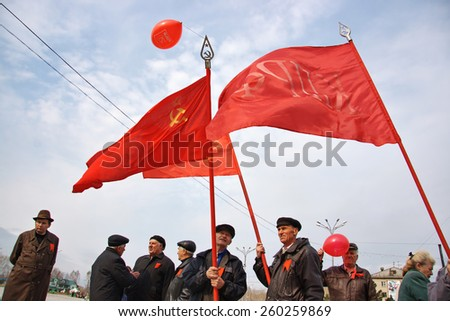 NOVOSIBIRSK, RUSSIA - CIRCA MAY 2009: Demonstrators with red communist flags. Opposition meeting on 1 of May in Russia - stock photo