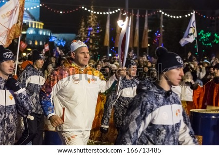 Novosibirsk, Russia - December 7, 2013 :Karelin, Alexander with the Olympic torch at the Olympic torch relay in Novosibirsk - stock photo