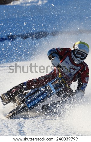 NOVOSIBIRSK, RUSSIA - DECEMBER 20, 2014: Roman Akimenko of Blagoveschensk during the semi-final rides of Russian Ice Speedway Championship.