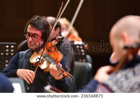NOVOSIBIRSK, RUSSIA - DECEMBER 5, 2014: Yuri Bashmet and ensemble Moscow Soloists on the rehearsal during the festival Classics. The festival joins the concerts of the World music stars - stock photo