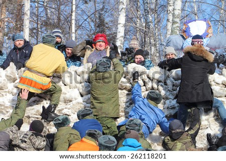 "NOVOSIBIRSK, RUSSIA - FEBRUARY, 22: People's   entertainment ""Fortress capture"".Shrovetide celebration in Novosibirsk. Taken on February 22, 2015 in Novosibirsk, Russia."
