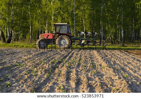 "Novosibirsk, Russia - June 20, 2016, the Tractor ""Belarus 92P"" is on the rest of the field in Novosibirsk on 20 June 2016."