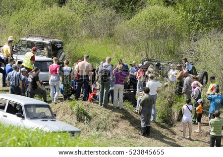 Novosibirsk, Russia - June 20, 2016: Unidentified people and SUVs in Novosibirsk on 20 June 2016.