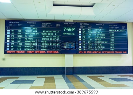 NOVOSIBIRSK,  RUSSIA - MARCH 02, 2016: timetable board at the airport Tolmachevo - stock photo