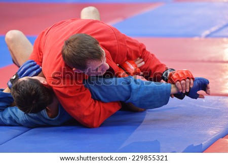 NOVOSIBIRSK, RUSSIA - OCTOBER 16, 2014: Unidentified sambo wrestlers during the open training. The event aimed to promote the MMA Friendship Cup which took place on November 8 - stock photo