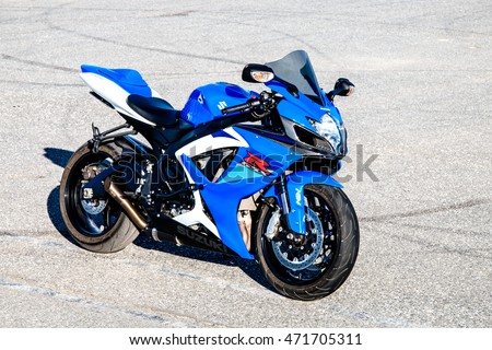 NOVYY URENGOY, RUSSIA - AUGUST 21, 2016: Blue bike Suzuki GSX-R750 parked at the dry tarmac.