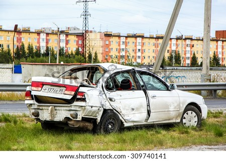 NOVYY URENGOY, RUSSIA - AUGUST 16, 2015: Crashed motor car Nissan Sunny at the city street. - stock photo