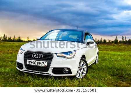 NOVYY URENGOY, RUSSIA - AUGUST 21, 2015: Motor car Audi A1 at the countryside. - stock photo