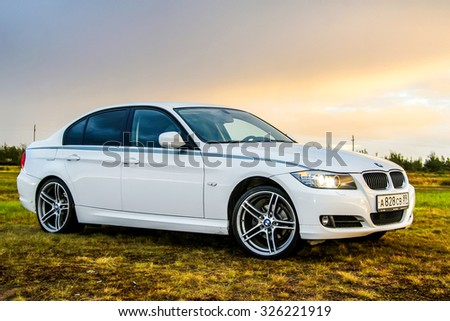 NOVYY URENGOY, RUSSIA - AUGUST 21, 2015: Motor car BMW E90 318i at the countryside.