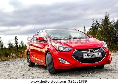 NOVYY URENGOY, RUSSIA - AUGUST 23, 2015: Motor car Hyundai Elantra at the countryside. - stock photo