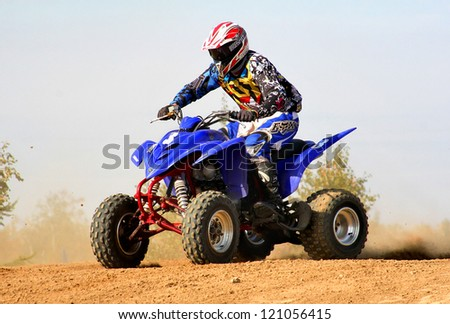 NOVYY URENGOY, RUSSIA - AUGUST 30: Undefined competitor's quad bike Yamaha No. 3 competes at the annual Russian Motocross Championship on August 30, 2012 in Novyy Urengoy, Russia. - stock photo