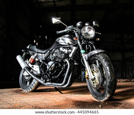 NOVYY URENGOY, RUSSIA - JULY 6, 2014: Sport motorcycle Honda CBR-series in the dark garage.