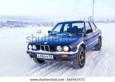 NOVYY URENGOY, RUSSIA - MARCH 24, 2013: Motor car BMW E30 324d in the city street. - stock photo