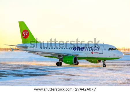 NOVYY URENGOY, RUSSIA - MARCH 4, 2015: S7 Airlines Airbus A319 taxiing at the Novyy Urengoy International Airport. - stock photo