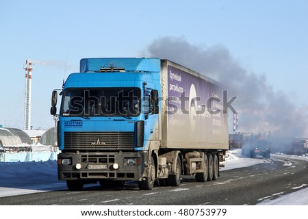 NOVYY URENGOY, RUSSIA - MARCH 21, 2013: Semi-trailer truck MAZ 5440 at the interurban road.