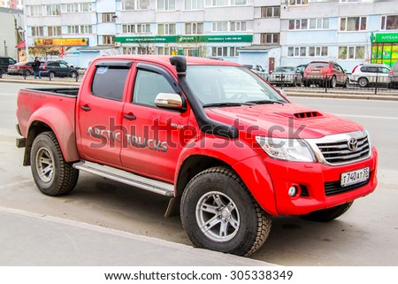 NOVYY URENGOY, RUSSIA - MAY 28, 2014: Motor car Toyota Hilux Arctic Trucks at the city street.