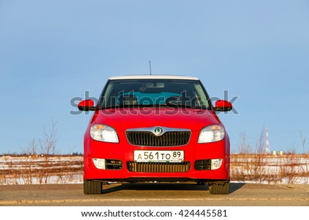 NOVYY URENGOY, RUSSIA - MAY 13, 2016: Red car Skoda Fabia SE at the background of a blue sky. - stock photo