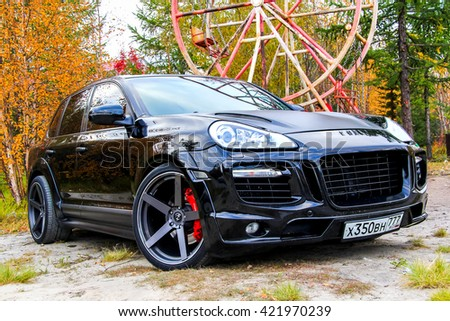 NOVYY URENGOY, RUSSIA - SEPTEMBER 5, 2015: Motor car Porsche 956 Cayenne at the countryside. - stock photo