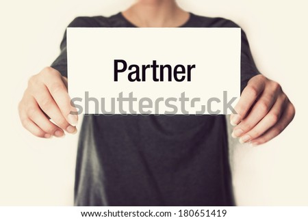 Now hiring advertisement. Female in black shirt showing or holding a card in retro vintage style - stock photo