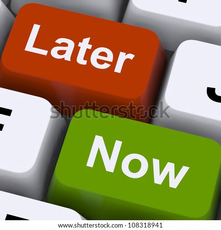 Now Or Later Keys Showing Delay Deadlines And Urgency - stock photo
