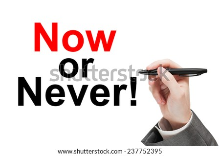 Now or never! Man writing a motivational concept  isolated on white background - stock photo