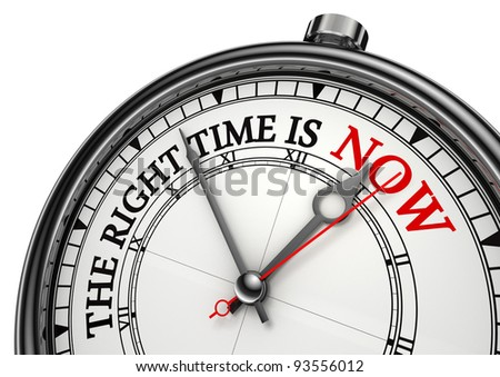 now the right time concept clock closeup on white background with red and black words - stock photo