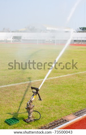 Nozzles are watering the field. care watering soccer fields. - stock photo