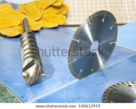 Nozzles for the puncher and a detachable diamond disk on a tile. - stock photo