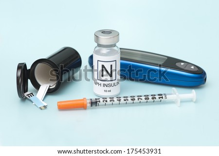 NPH Insulin with glucometer, test strips, and syringe.