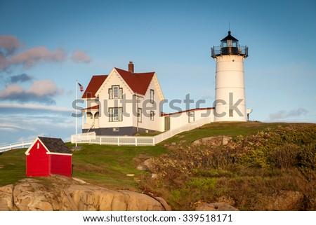 Nubble Lighthouse at sunset, Cape Neddick, Maine, USA - stock photo