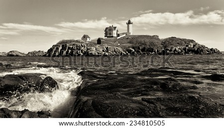 Nubble Lighthouse on a beautiful clear day in sepia tone - stock photo