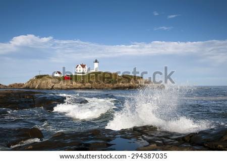 Nuble lighthouse is an island lighthouse in Maine near the main shoreline. - stock photo