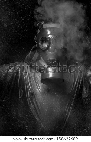 Nuclear attack. A man in a gas mask in the smoke. artistic background - stock photo