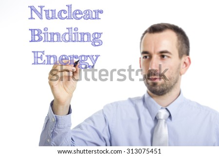Nuclear Binding Energy - Young businessman writing blue text on transparent surface