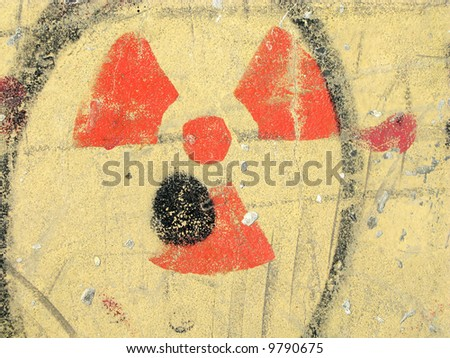 Nuclear danger radiation hazard symbol painted on the wall - stock photo