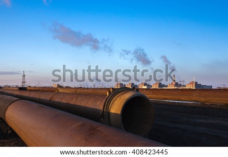 Nuclear energy and pollution. huge plant and pipes at sunset.