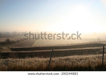 Nuclear explosion or just sunrise on foggy morning? :) - stock photo