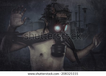Nuclear man, dressed with gas mask - stock photo