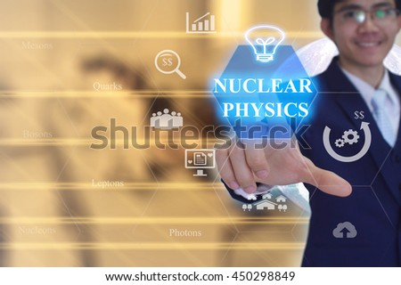 NUCLEAR PHYSICS  concept presented by  businessman touching on  virtual  screen -image element furnished by NASA - GOLDEN TONED AND  DOUBLE EXPOSURE