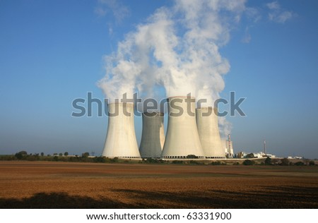 nuclear power plant and agriculture field - stock photo