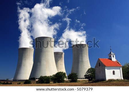 Nuclear power plant and chapel - stock photo