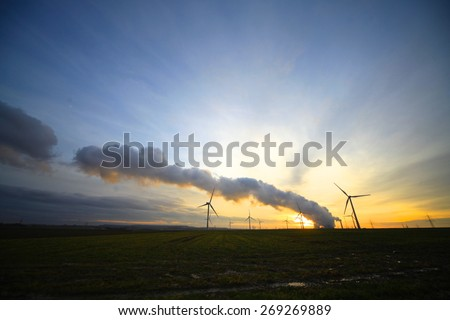 Nuclear Power Plant at sunset with Wind Turbines in Germany - stock photo