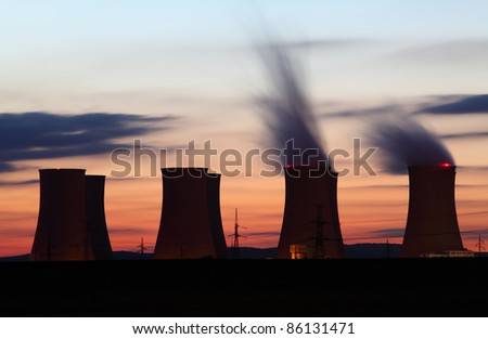 Nuclear power plant by sunset - stock photo