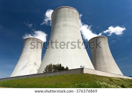 Nuclear power plant Dukovany - cooling towers and beautiful sky - Czech Republic - stock photo